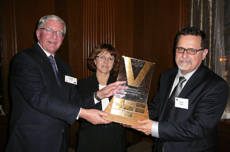 Ian Marshall presents the parents of Ozren Jungic with the Churchill Communications Challenge Trophy and the first prize 2010